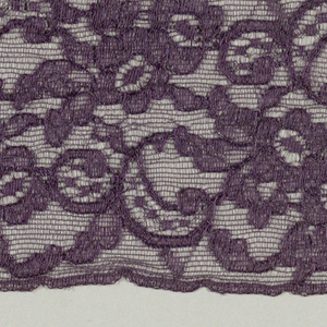 Purple lace fragment showing a continuous floral pattern.