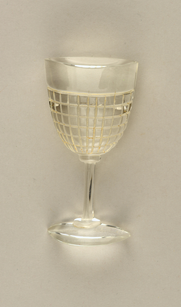 Clear brooch in the form of a stemmed wine glass.