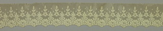 Border with a design of joined flower and leaf motifs with dots and a scalloped edge.