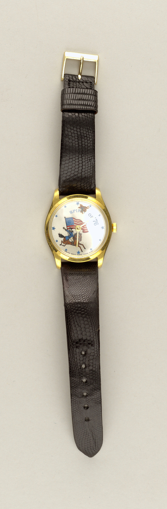 "Black leather band, with standard buckle closure. Face of watch depicts Paul Revere on horseback carrying U.S. flag. Text ""Spirit of '76"" with blue stars on face. Glass crystal."