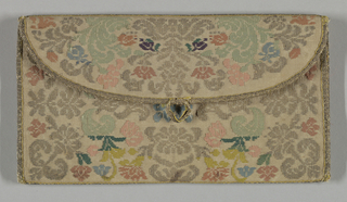 Flat envelope-shaped pocketbook woven in cream-colored silk with pattern in light-colored silk and metallic thread. Symmetrical arrangement of stylized floral sprays. Bound on edges with narrow gold braid. Loop of the same for fastening flap, but button is missing. Lined in bright coral taffeta. Same pattern on both sides.