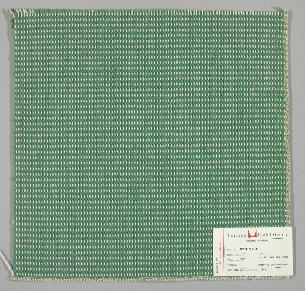 """Plain weave in green and white with every third weft doubled. Warp contains supplementary binding warps. White warp yarns create """"dot"""" effect. Number 352."""