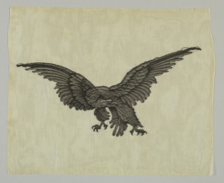 Fragment of black silk lace in the form of a flying eagle. Mounted on net.