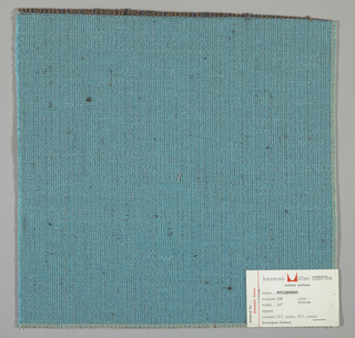 Weft-faced plain weave with doubled warps in overall turquiose color. The weft consists of heavy turquoise yarns. The doubled warps are comprised of fine threads in blue and brown. Number 698.