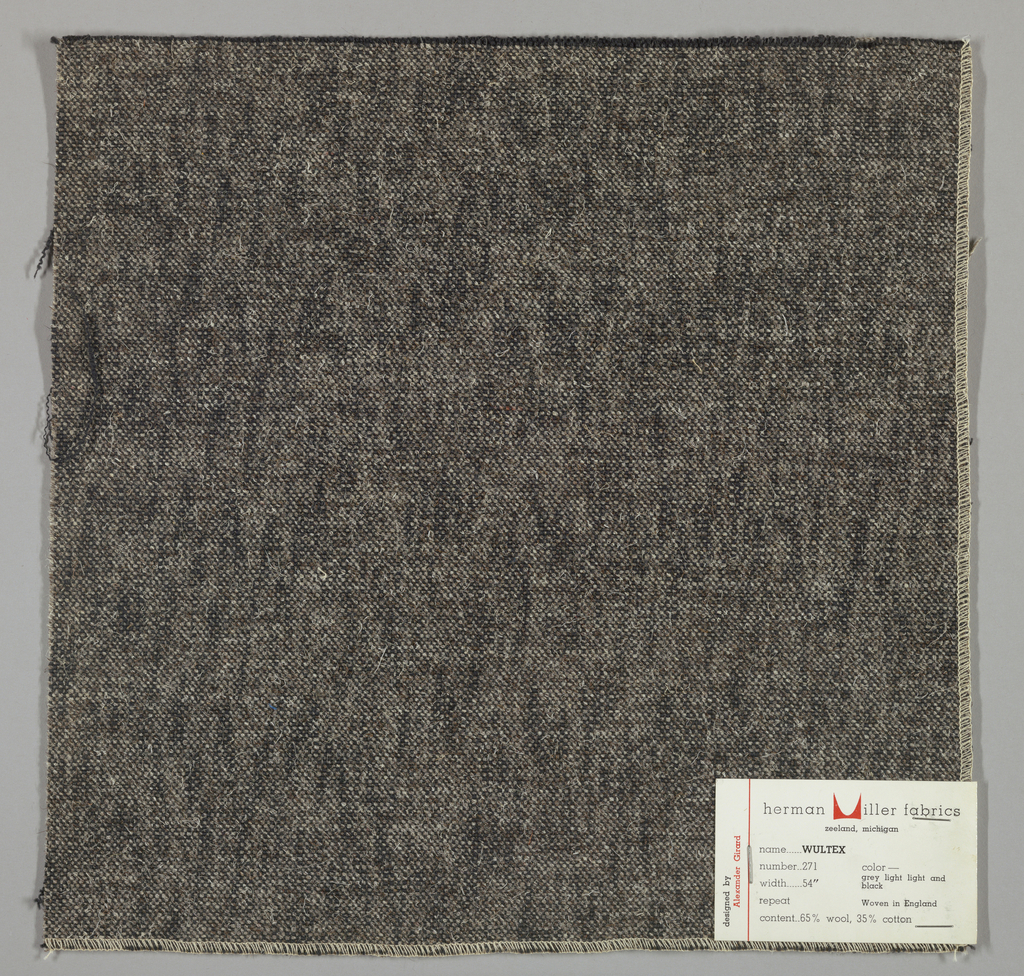 Plain weave in black, grey and white. Warps are thick black yarns while the wefts are loosely twisted grey and white yarns. Surface has a variegated appearance. Number 271.