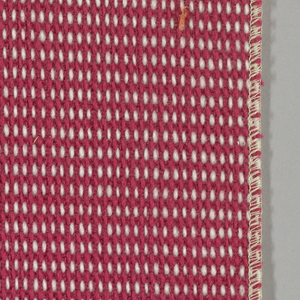 """Plain weave in magenta and white with every third weft doubled. Warp contains supplementary binding warps. White warp yarns create """"dot"""" effect. Number 355."""