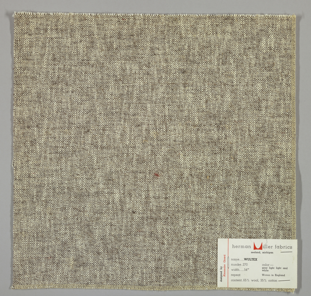 Plain weave in brown and white. Warps are thick white yarns while the wefts are loosely twisted brown and white yarns. Surface has a variegated appearance. Number 270.