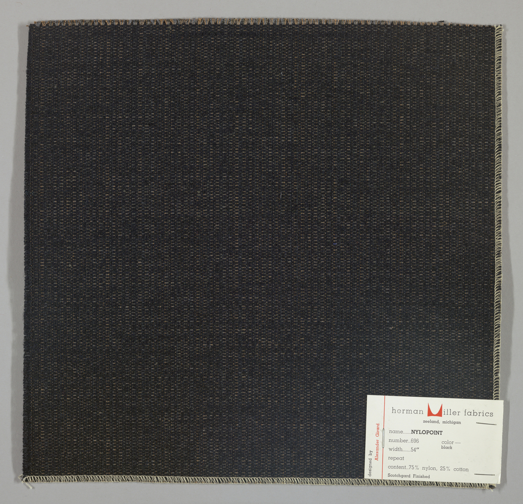 Weft-faced plain weave with doubled warps in overall black color. The weft consists of heavy black yarns. The doubled warps are comprised of fine threads in blue and brown. Number 696.