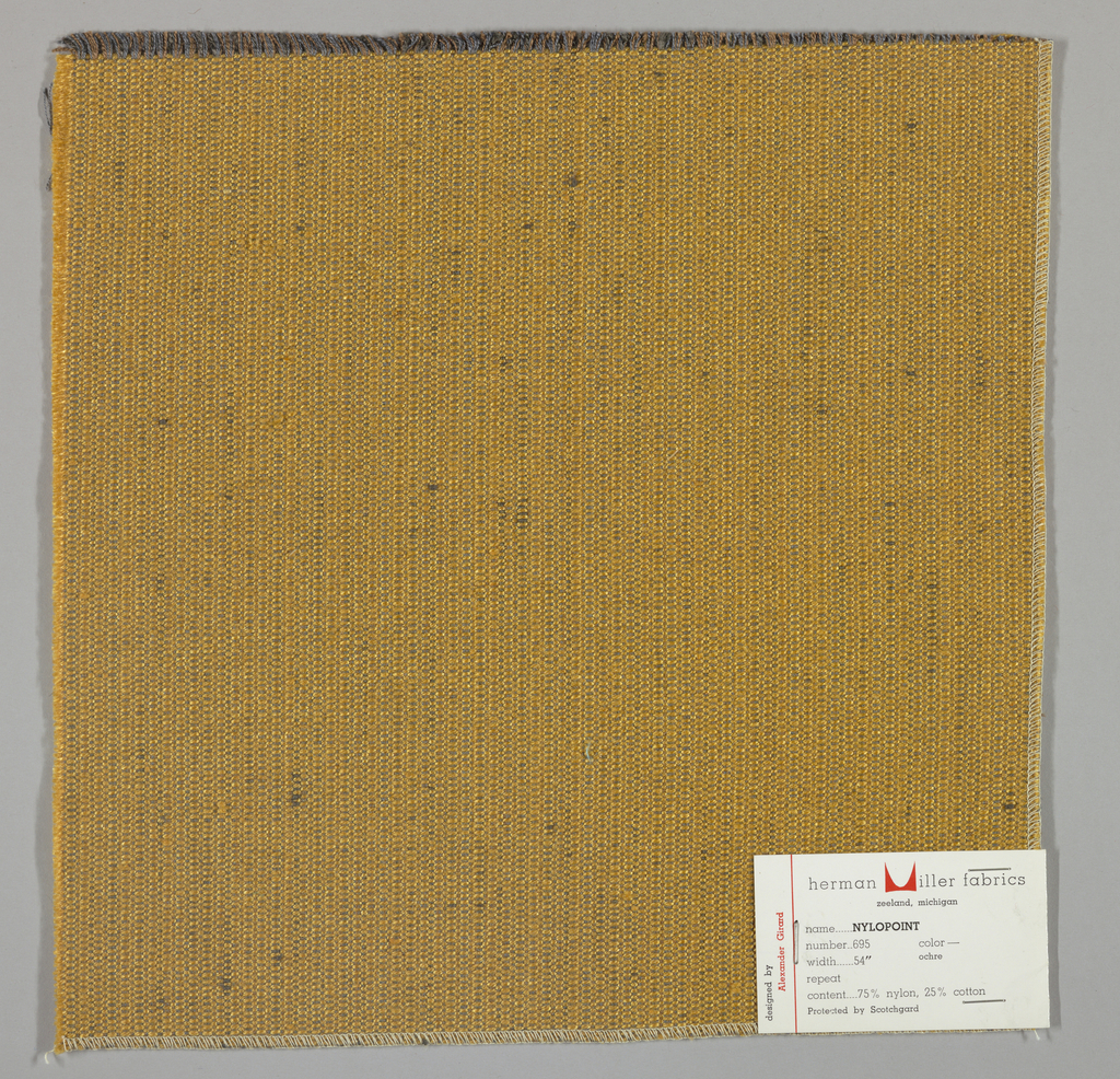 Weft-faced plain weave with doubled warps in overall tan color. The weft consists of heavy tan yarns. The doubled warps are comprised of fine threads in blue and brown. Number 695.