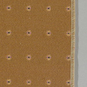 Warp-faced twill in tan with supplementary warp patterning used to create pink and yellow dots with black centers. Number 343.