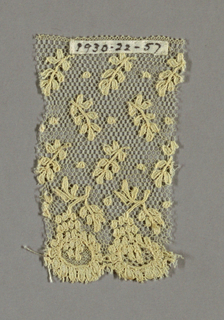 Alençon-type with a net ground, scattered leaves and floral border.