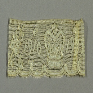 Border fragment in a design showing the royal crown and dates 1910–1935, commemorating the 25th anniversary of the accession of George V.