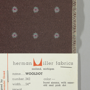Warp-faced twill in brown with supplementary warp patterning used to create pink and green dots with red centers. Number 342.