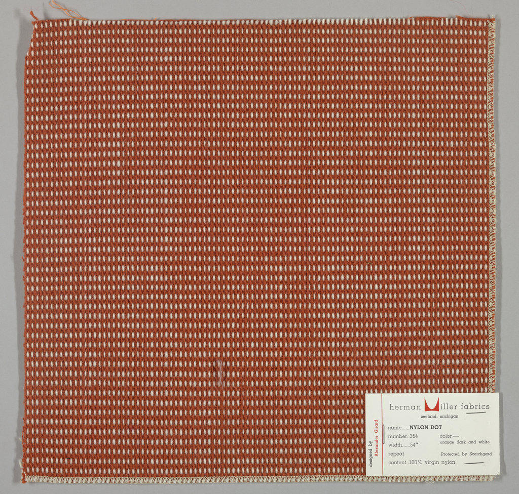 """Plain weave in dark orange and white with every third weft doubled. Warp contains supplementary binding warps. White warp yarns create """"dot"""" effect. Number 354."""