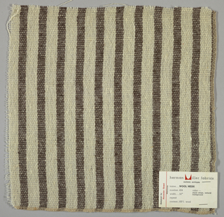 Plain weave in vertical stripes of off-white and dark brown. Warp is off-white and brown and weft is off-white. Yarns are loosely twisted. Number 404.