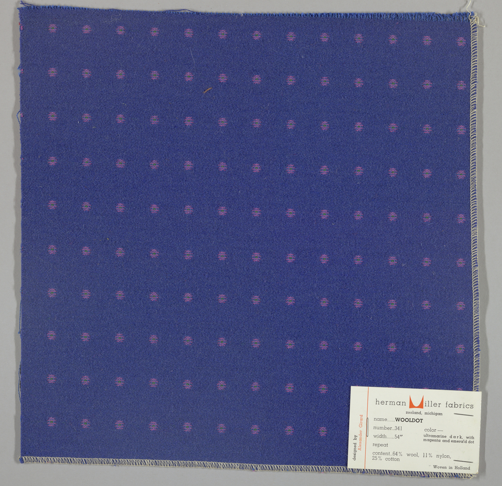 Warp-faced twill in blue with supplementary warp patterning used to create pink dots with green centers. Number 341.