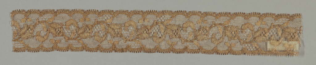 Dull reddish lace border showing a continuous floral pattern.