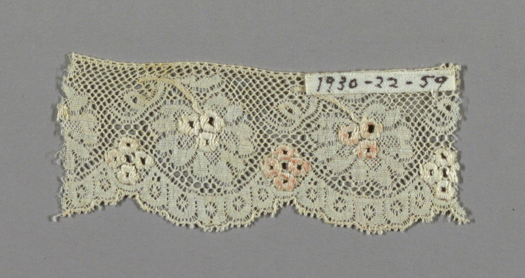 Valencienne-type with embroidered details.
