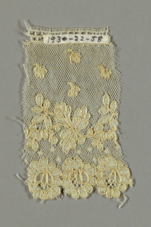 Alençon-type with scattered flowers and a floral border on net.