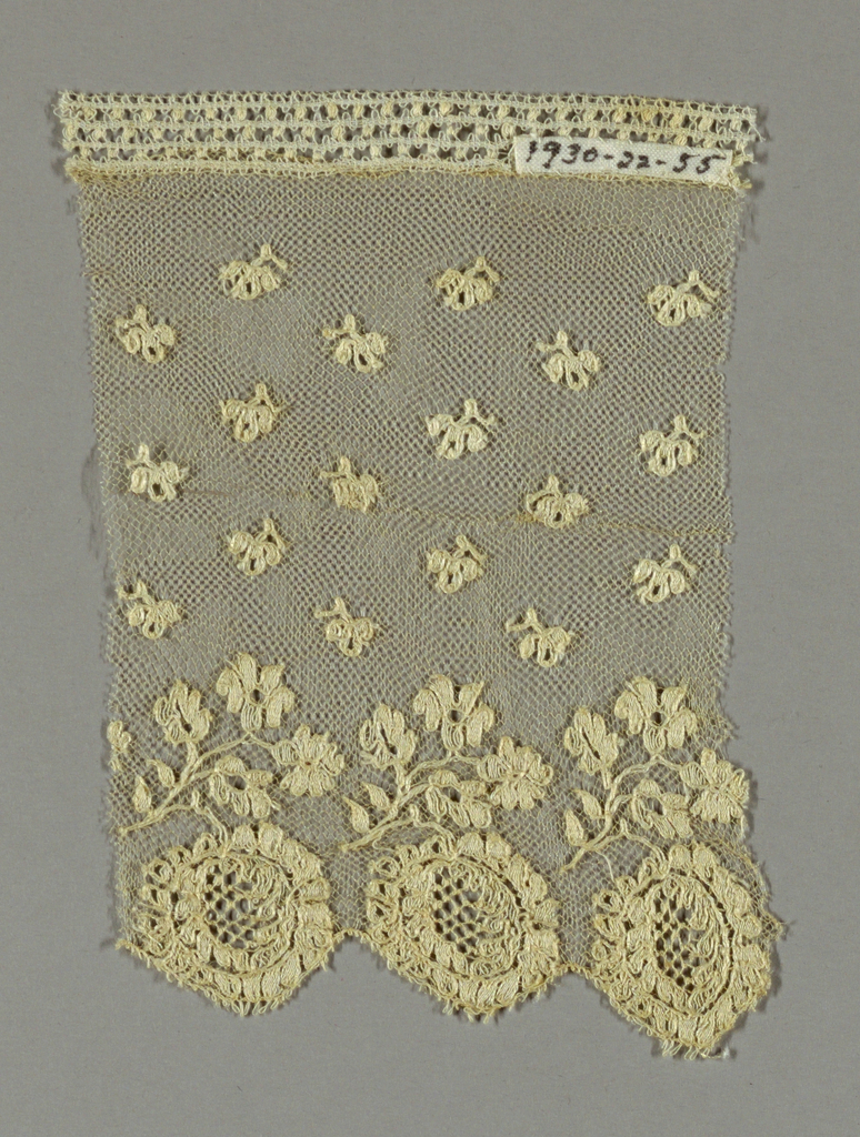 Net ground with scattered ornaments and a floral border.