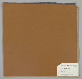 Weft-faced twill weave in tan. Number 464.