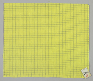 Plain weave in a yellow and olive green windowpane plaid.