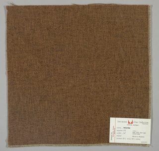 Plain weave in tan and dark brown. Warps are thick tan yarns while the wefts are loosely twisted tan and dark brown yarns. Surface has a variegated appearance. Number 272.