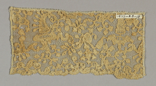 Pattern formed of leaves and cornucopia on hand made net. 18th c