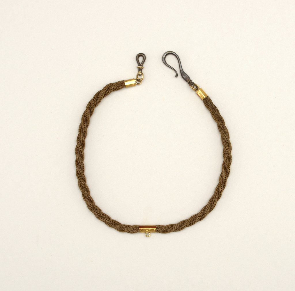 Chain of three strands made of human hair (brown) twisted together; gold mountings at either end and in center; hook at one end, clasp at the other.