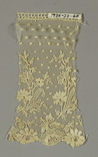 Dots and floral border on net ground.