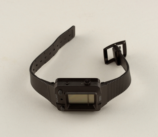 "Black molded plastic housing and strap with standard buckle closure. Case for watch is square, with window and buttons for games: ""Missile Strike,"" ""Firing Squad,"" ""Alien Assault,"" ""Blast Away."""