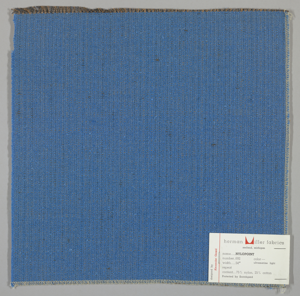 Weft-faced plain weave with doubled warps in overall light blue color. The weft consists of heavy light blue yarns. The doubled warps are comprised of fine threads in blue and brown. Number 692.