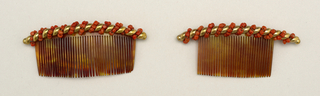 A) and B) Tortoise shell side comb with cresting of gold and coral beads.