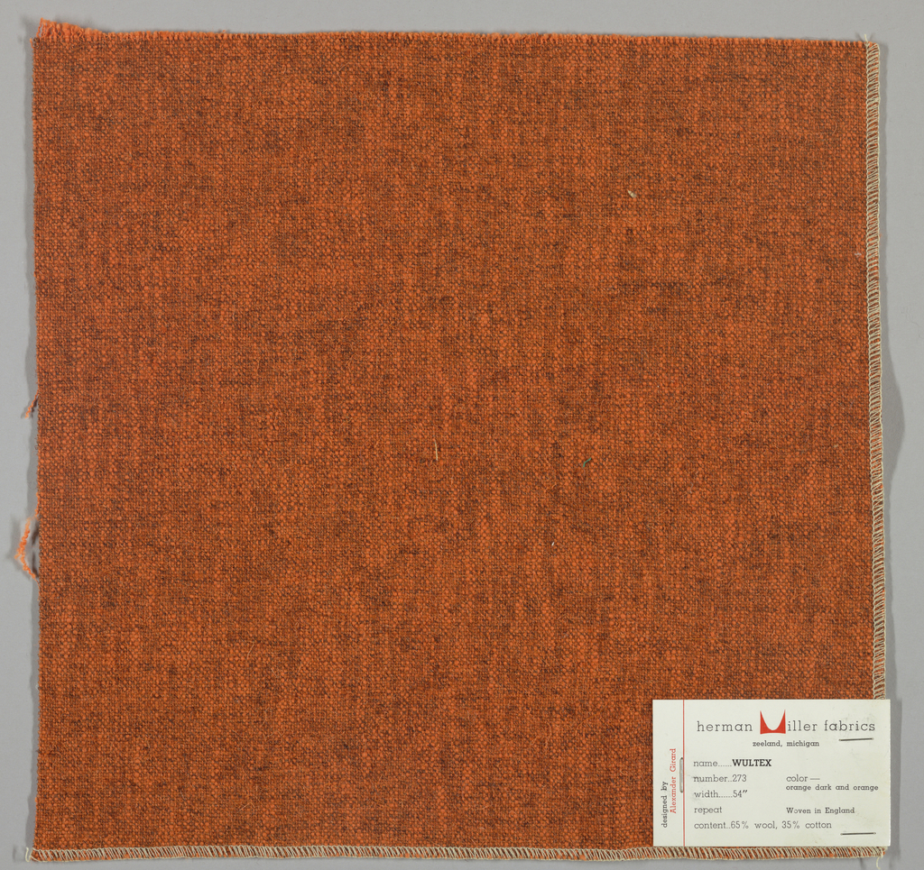 Plain weave in orange and dark brown. Warps are thick orange yarns while the wefts are loosely twisted orange and dark brown yarns. Surface has a variegated appearance. Number 273.