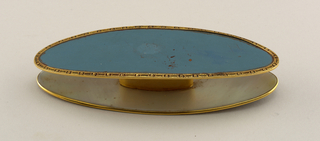 Two elliptical metal plaques with slightly incurved ends, the outer surfaces enamelled opaque light blue and bordered by narrow pierced and chased gold bands; inner surfaces mother-of-pearl; gold stem.