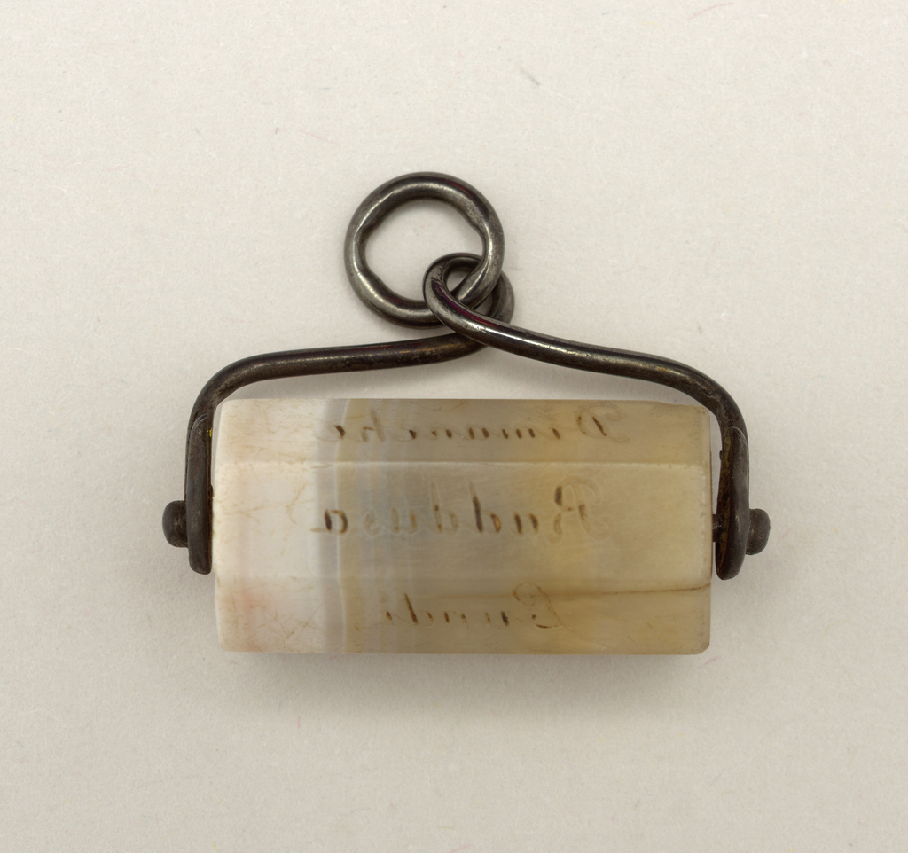 "Cylindrical piece of marble in steel setting.   The marble is eight-sided: the word ""Raddusa"" appears on one face and the French names of the days of the week on the other."