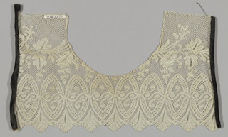 Fragment of flounce made into a collar. Design of oval medallions enclosing S-shaped scrolls.