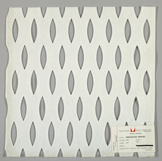 White felt with a repeated pattern of lozenge cut-outs. Number 495.