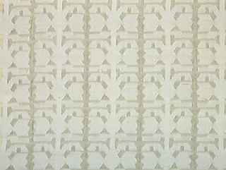 Symmetrical geometric pattern in white on an off-white ground.