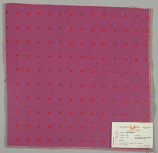 Warp-faced twill in dark pink with supplementary warp patterning used to create crimson dots with green centers. Number 340.