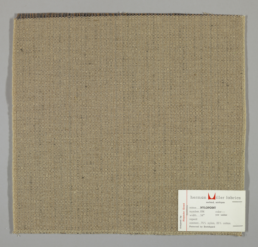 Weft-faced plain weave with doubled warps in overall light brown color. The weft consists of heavy light brown yarns. The doubled warps are comprised of fine threads in blue and brown. Number 694.