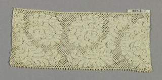 Valenciennes fragment with a loosely massed floral design.