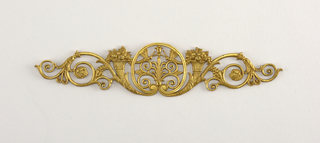 Foliate srolls with cornucopiae centered by anthemion motif.