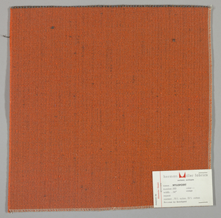 Weft-faced plain weave with doubled warps in overall orange color. The weft consists of heavy orange yarns. The doubled warps are comprised of fine threads in blue and brown. Number 693.
