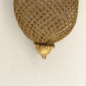 A pair of earrings with leafs dangling oval globes, weaved in hair, set in gold.