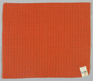 Plain weave in an orange and dark orange windowpane plaid.