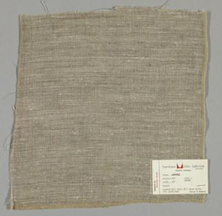 Plain weave in beige. Warps threads are beige while the weft is comprised of white threads loosely spun with black goat's hair. This gives a variegated surface appearance. Number 420.