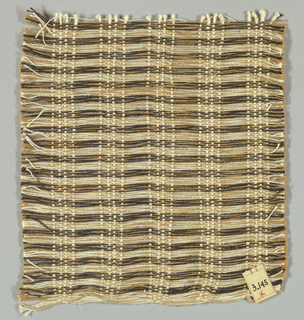 Plain weave in tan, brown and white with long weft floats. White warp yarns are in groups of four. Weft is comprised of long floats in tan, brown and white.