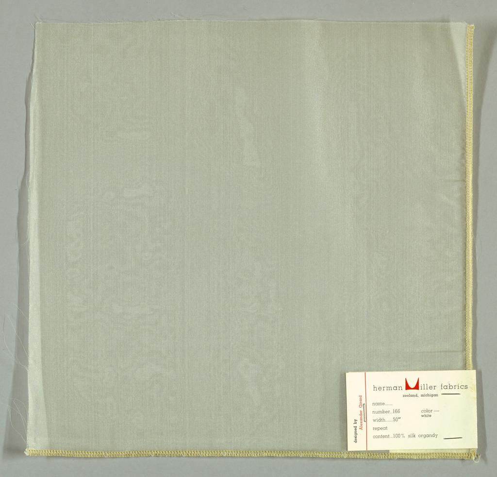 Off-white sheer plain weave.