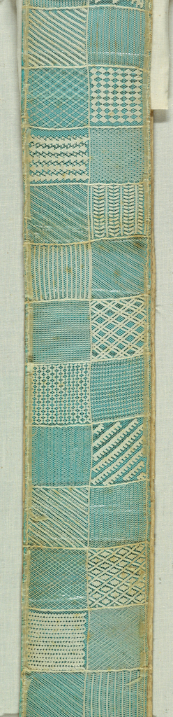 Seventy-eight needlework patterns embroidered on a ground of hexagonal mesh. Mounted on stiff green paper.